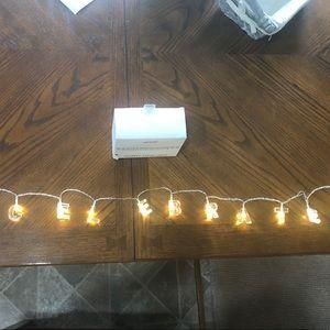 """Celebrate"" string lights party decor"